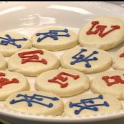 Photo of cookies with opposing sports team logos on them